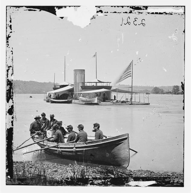 [James River, Va. Monitor U.S.S. Onondaga; soldiers in rowboat in foreground]