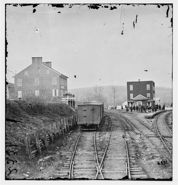 Hanover Junction, Pennsylvania. View of railroad station and boxcars