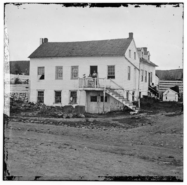 Gettysburg, Pennsylvania. John L. Burns cottage. (Burns seated in doorway)