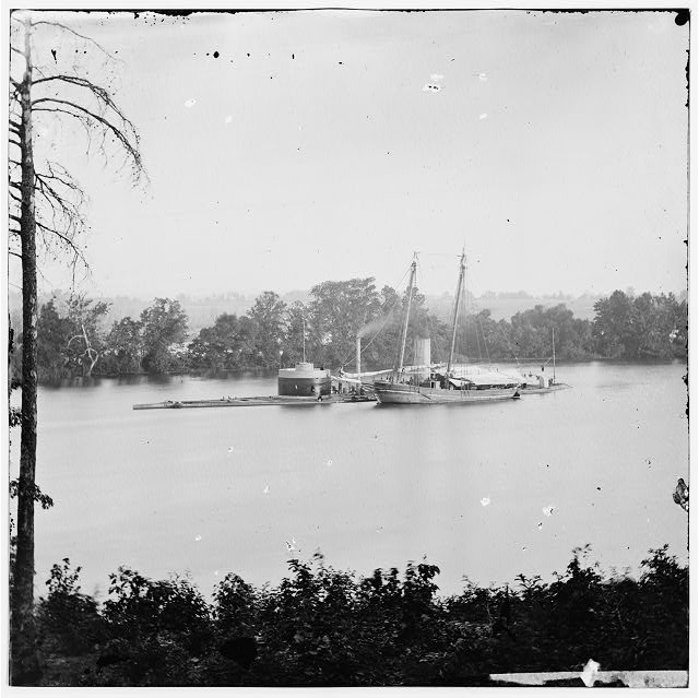 James River, Virginia. U.S. monitor CANONICUS taking on coal from a schooner