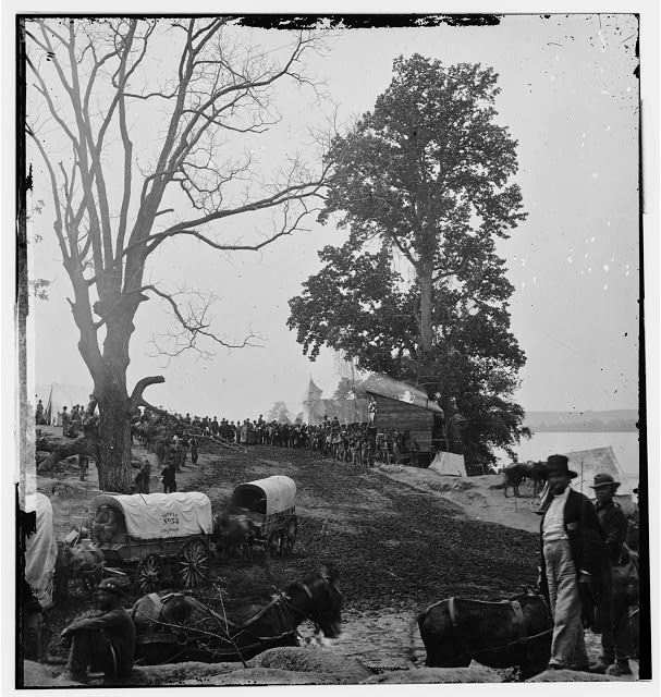 [Belle Plain, Va. Wagons of the Sanitary Commission and a crowd at the landing]