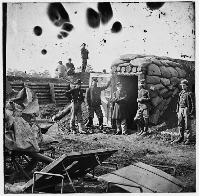 [Fort Burnham, Va. (the former Confederate Fort Harrison). Federal soldiers in front of bomb-proof headquarters]