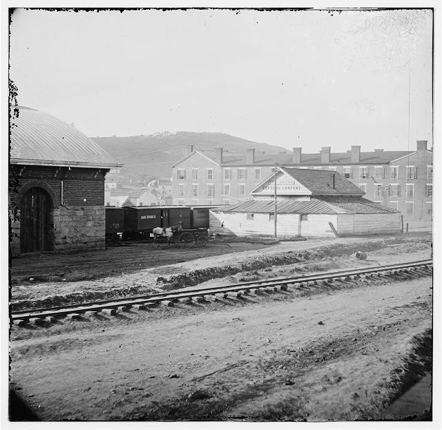 Chattanooga, Tennessee. Adams Express office, the Crutchfield house with Cameron Hill in the distance