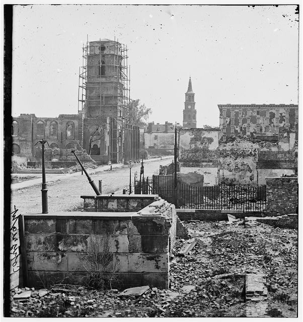 Charleston, South Carolina. View on Meeting Street, looking south, showing St. Michael's Church, the Mills house, ruins of the Circular Church and theatre ruins in the foreground