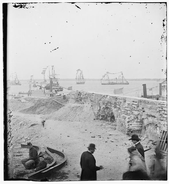 [Charleston, S.C. Federal squadron dressed with flags for the anniversary of Maj. Robert Anderson's surrender (1861) seen from a parapet of Fort Sumter]