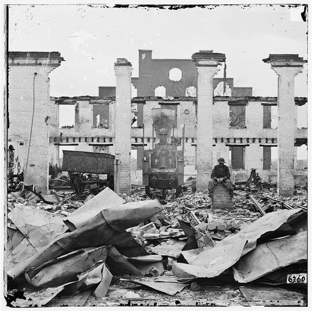 Richmond, Virginia. Ruins of Richmond & Petersburg Railroad depot. (Destroyed locomotive shown)