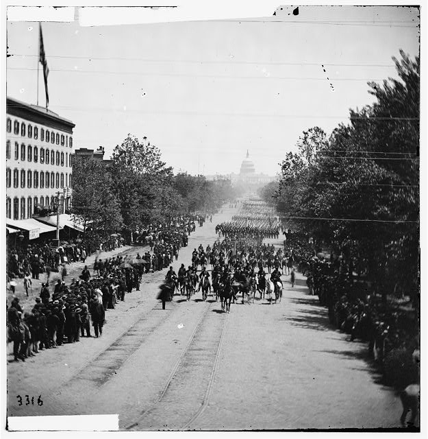 Washington, District of Columbia. The Grand Review of the Army. Gen. Horatio G. Wright, staff and 6th Corps passing on Pennsylvania Avenue near the Treasury