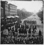 Washington, District of Columbia. The Grand Review of the Army. [Cavalry?] passing on Pennsylvania Avenue near the Treasury. (1865)