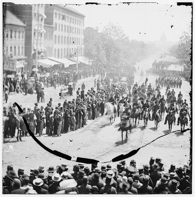 Washington, District of Columbia. The Grand Review of the Army. Gen. Francis P. Blair, staff and infantry of 17th Corps passing on Pennsylvania Avenue near the Treasury. (Army of Tenn.)