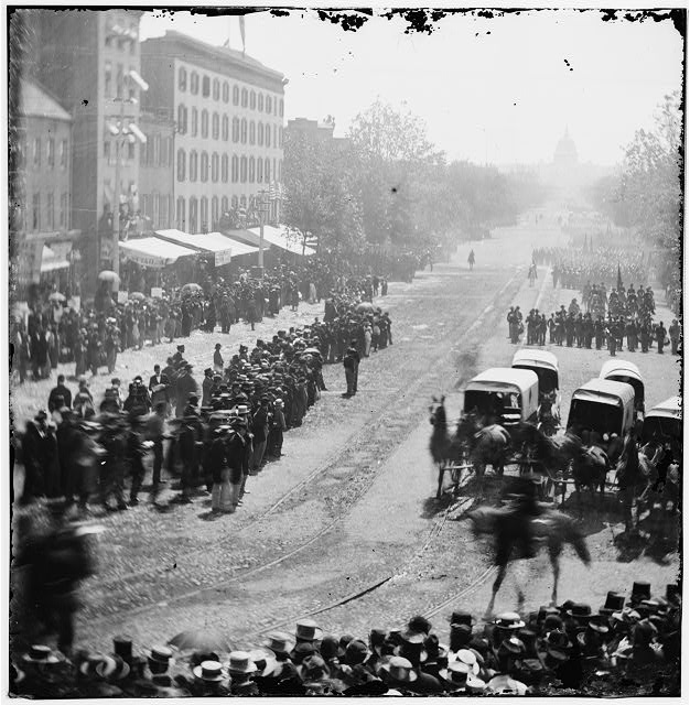 [Washington, D.C. Group of ambulances followed by band and infantry units on Pennsylvania Avenue near the Treasury]