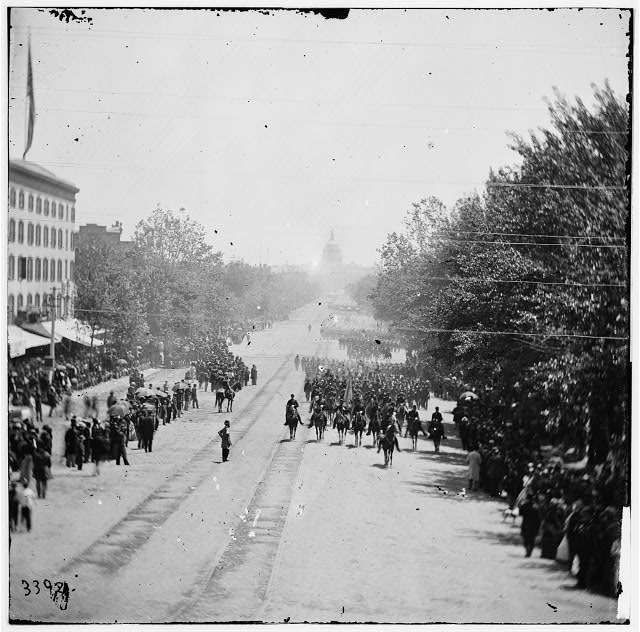 [Washington, D.C. Maj. Gen. Horatio G. Wright, staff and units of 9th Army Corps passing on Pennsylvania Avenue near the Treasury]