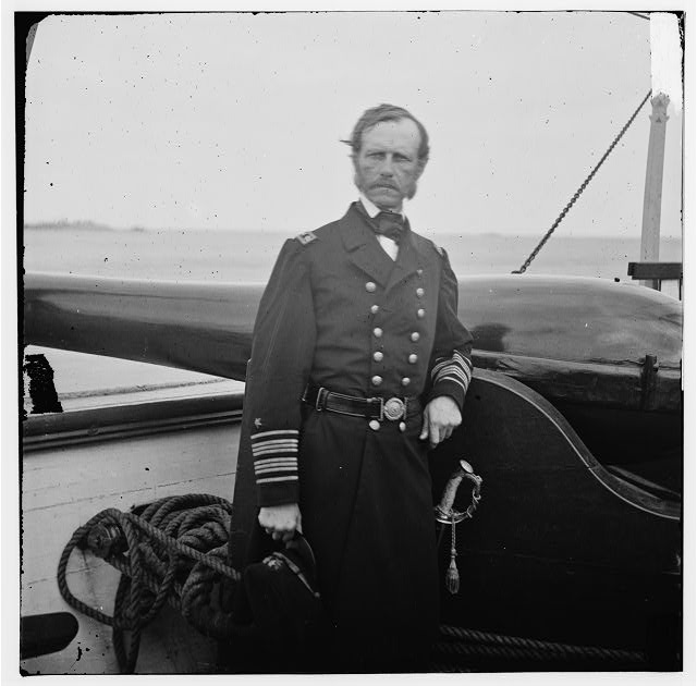 Charleston Harbor, South Carolina. Rear Adm. John A. Dahlgren standing by a Dahlgren gun on deck of U.S.S. PAWNEE