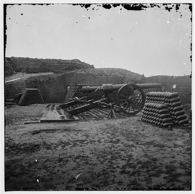 [Morris Island, S.C. Two 100-pdr. Parrott guns and stacks of shells inside Fort Putnam]