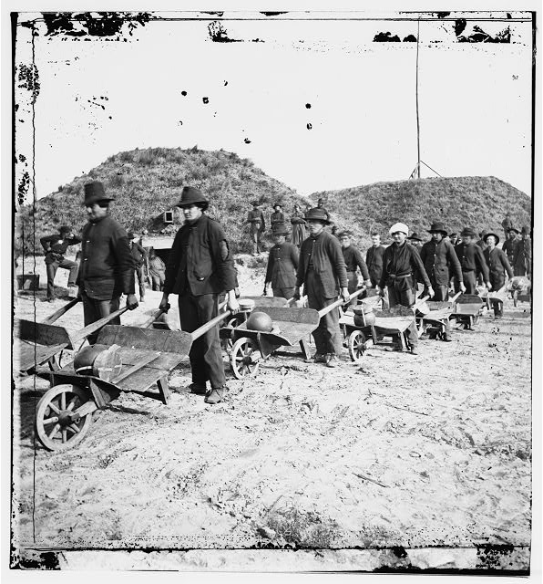 [Savannah, Ga., vicinity. Sherman's troops removing ammunition from Fort McAllister in wheelbarrows]