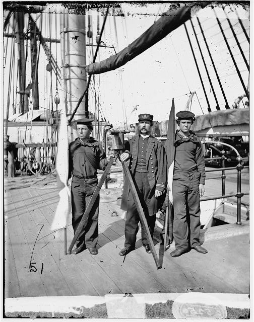 [Unknown location. Signalmen of Rear Admiral John A. Dahlgren's flagship receiving a message from the Georgia shore]