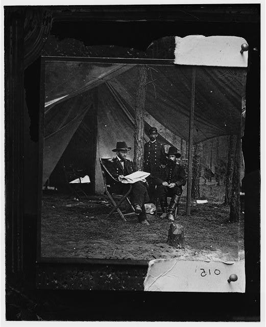 [General Grant, Lt. Col. Bowers, and General Rawlins at Grant's headquarters, Cold Harbor]