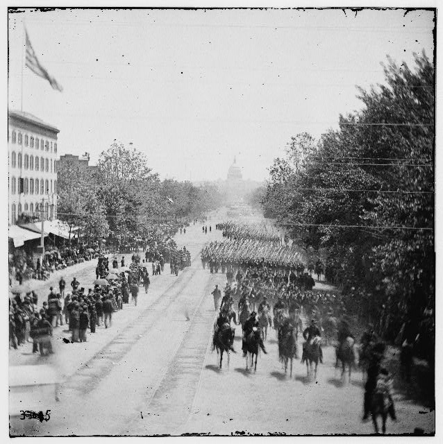 Washington, District of Columbia. The Grand Review of the Army. Infantry passing on Pennsylvania Avenue near the Treasury