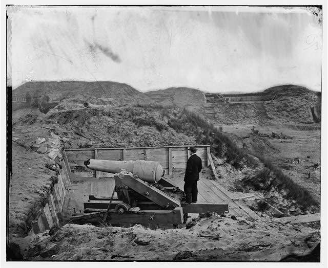 [Fort Fisher, N.C. Interior view, with heavy gun broken by bombardment]
