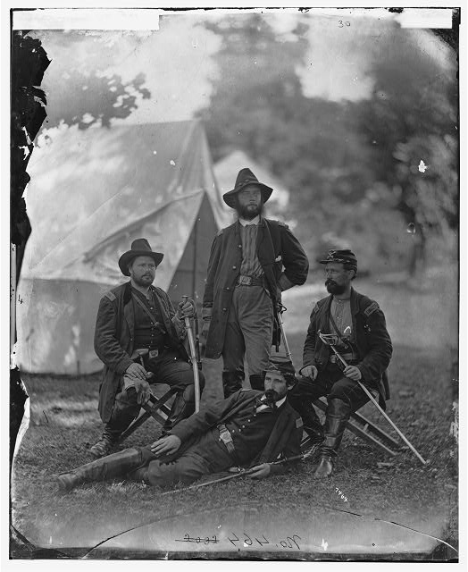 [Westover Landing, Va. Col. James H. Childs (standing) with other officers of the 4th Pennsylvania Cavalry]