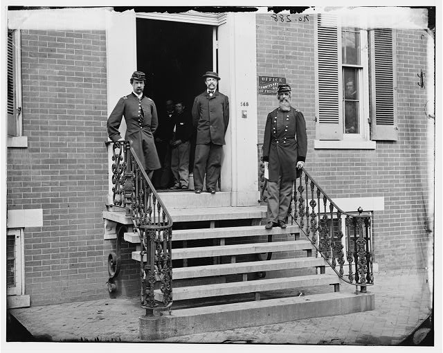 [Washington, D.C. Gen. William Hoffman, Commissary General of Prisoners (at right) and staff on steps of office, F. St. at 20th NW]