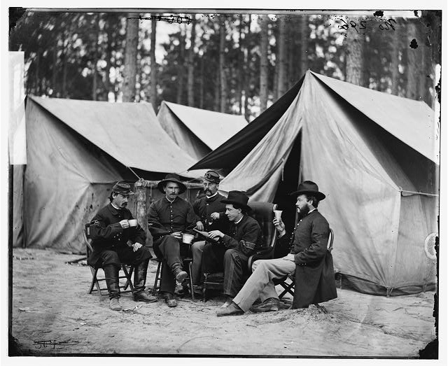[Petersburg, Va. Hospital stewards of 2d Division, 9th Corps, in front of tents]