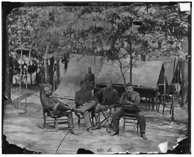 Petersburg, Virginia. Officers of 1st Massachusetts Cavalry at Army of the Potomac headquarters: unknown, Capt. Edward A. Flint, Capt. Charles Francis Adams, Jr., Lt. George H. Teague