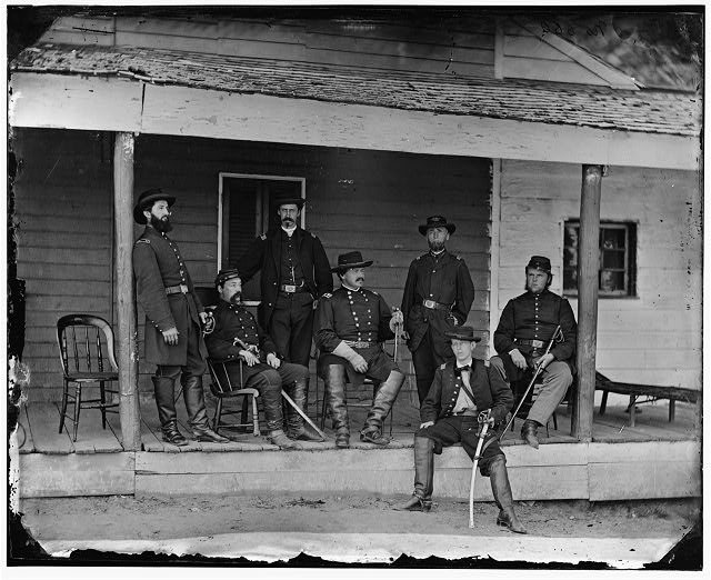 [Washington, D.C. Maj. Gen Alexander M. McCook (center) and staff on porch of quarters, Brightwood (7th Street Road near present Sheridan St.]