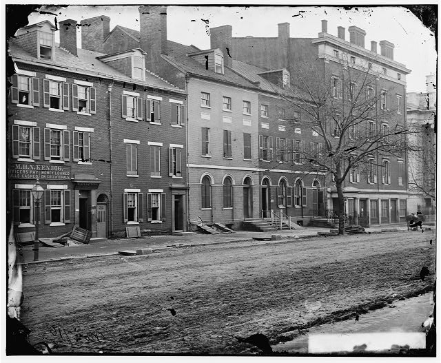 Washington, District of Columbia. Sanitary Commission storehouse and adjoining houses at 15th and F Street, N.W.
