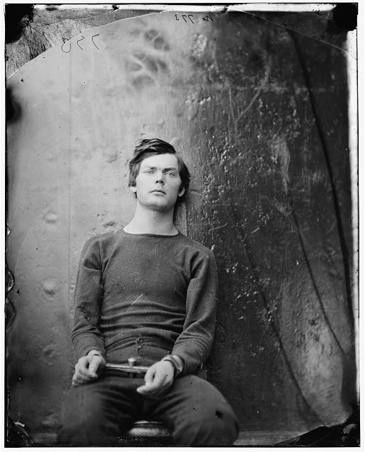 [Washington Navy Yard, D.C. Lewis Payne, in sweater, seated and manacled]