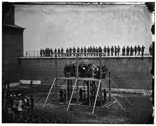 [Washington, D.C. Gen. John F. Hartranft reading the death warrant to the conspirators on the scaffold]