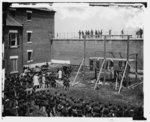 Washington, D.C. Hanging hooded bodies of the four conspirators; crowd departing (1865)
