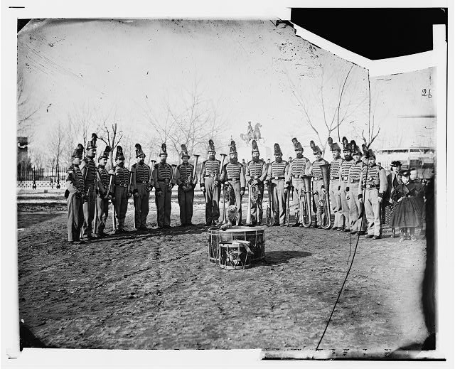 [Washington, D.C. Band of 9th Veteran Reserve Corps, in shakoes and frogged jackets, at Washington Circle]