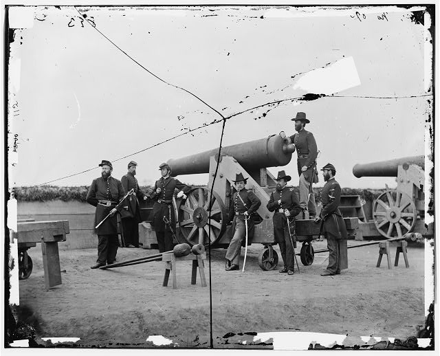 [Washington, D.C., vicinity. Seven officers by a big gun in a fort]