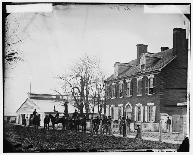 "[Washington, D.C. Quarters of Gen. Alfred Pleasonton, and ""Government Horse Shoeing Shop"" at left; 21st St. near F NW]"