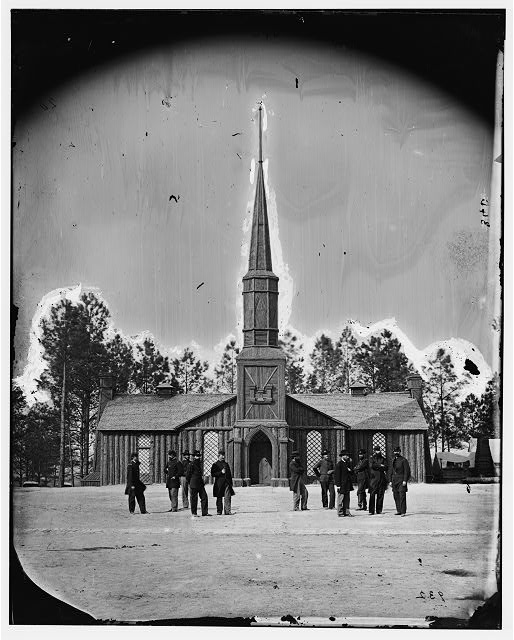 Poplar Grove, Virginia. Log church built by the 50th New York Engineers, with the engineer insignia above the door