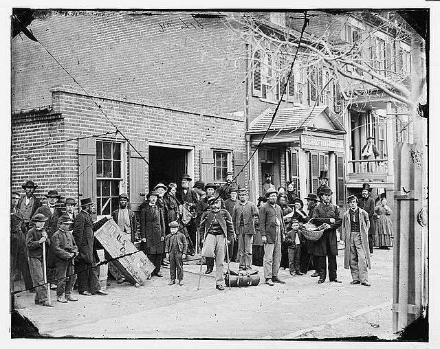 Washington, District of Columbia. Maimed soldiers and others before office of U.S. Christian Commission