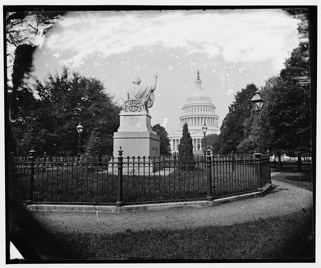 [Rear view, statue of Washington, with view of U.S. Capitol building in background]