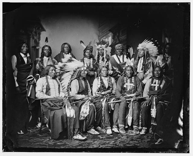 Red Cloud and Indians. Standing - Red Bear (Sons Are?), Young Man Afraid of his Horse, Good Voice, Ring Thunder, Iron Crow, White Tail, Young Spotted Tail. Seated - Yellow Bear, Jack Red Cloud, Big Road, Little Wound, Black Crow