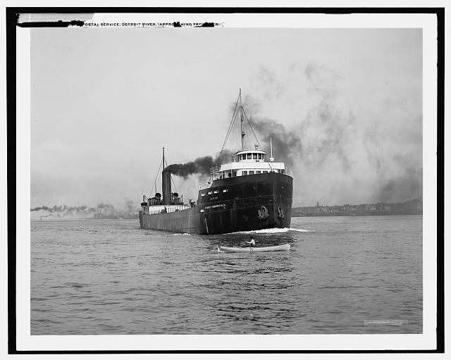 [U.S. marine postal service, Detroit River, approaching freighter]