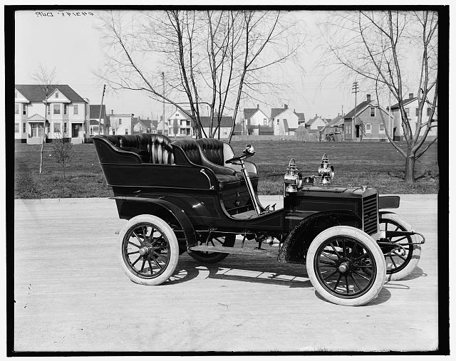 [Northern Manufacturing Company touring car, three-quarter view]