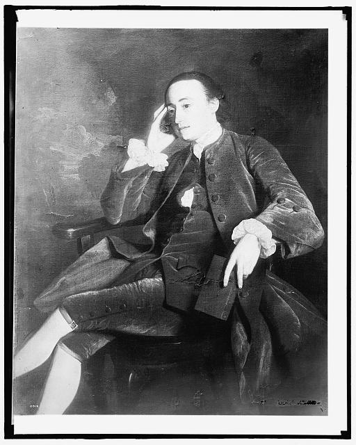 [John Bours, seated in chair, full length portrait]