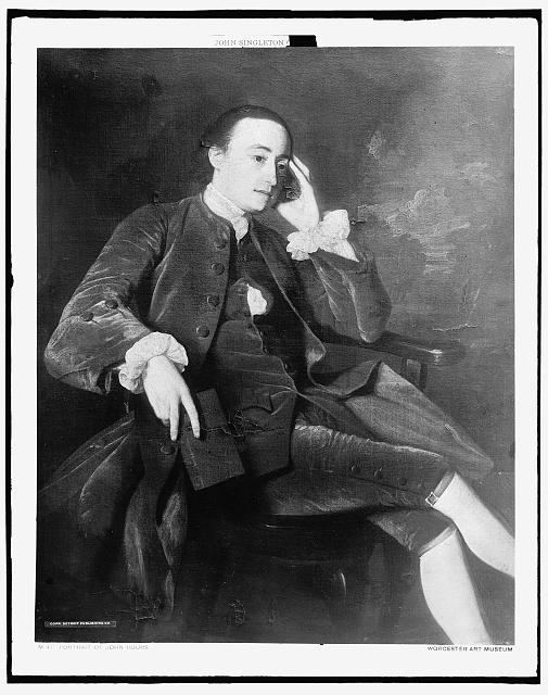 [John Bours seated in chair, full-length portrait]