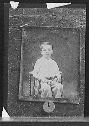 [Boy, seated]