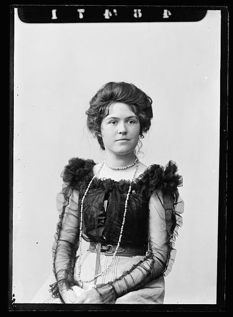 [Louise Jackson in blouse with transparent sleeves, half-length portrait]