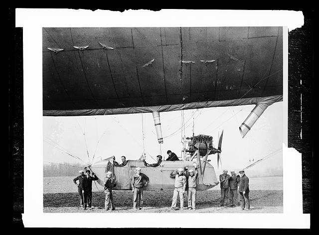 [Group of men boarding an airship]