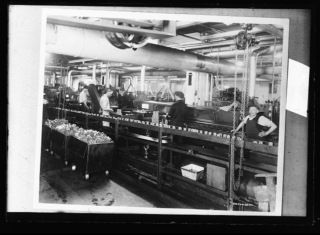[Factory workers on assembly line for bearings]