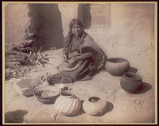 Hopi woman making pottery
