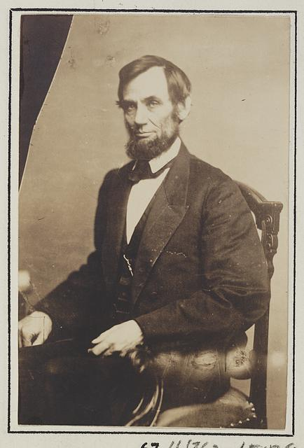 [President Abraham Lincoln, three-quarter length portrait, seated, May 16, 1861]