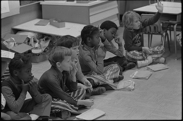 [First grade class of African American and white school children seated on the floor, Albemarle Road Elementary School, Charlotte, North Carolina]