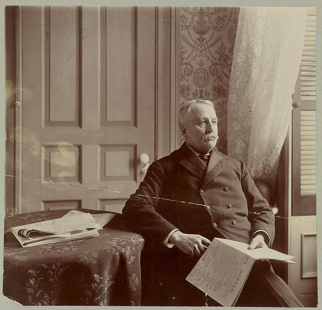 [Senator Addison Gardner Foster, Republican from Washington, seated with a newspaper]